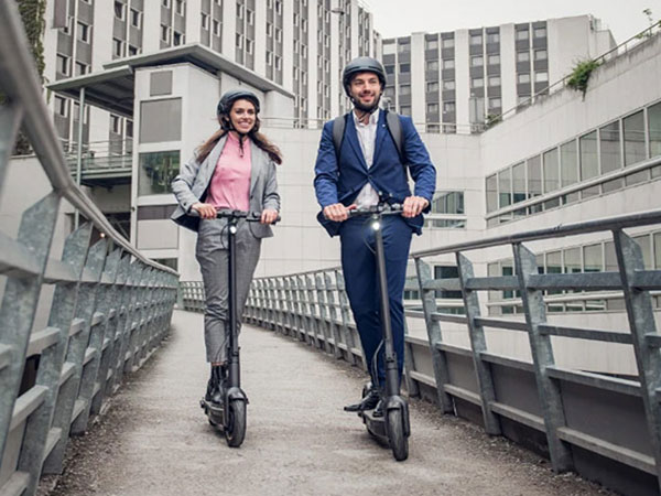 Professional Man and Woman on kickscooters