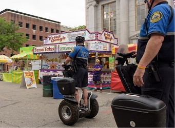 Policeman on Segway PT during community event