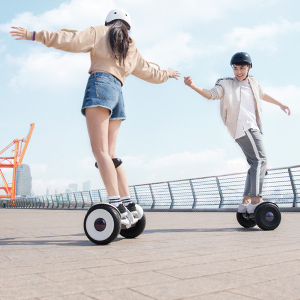 Young man and woman using Ninebot S