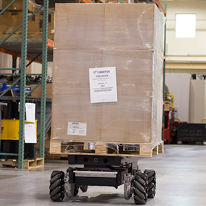 rmp 440 flex omni in warehouse with large box on top of it