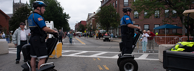 Two Policemen riding Segway Patrollers during community event