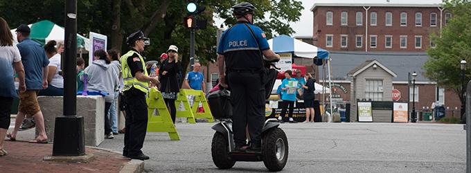 Policeman on i2 SE Patroller during community event